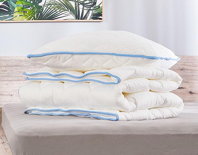 Ковдри та подушки Siena